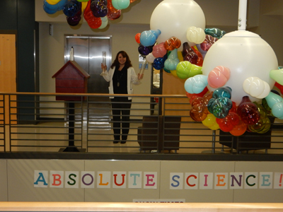 Static electricity experiment with balloons and light fixtures